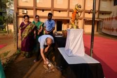 Hon.-Jt.-Secretary-Shri.-H.-Bhatawadekar-Sir-offering-coconut-to-Lord-Hanuman